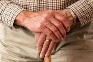 Elderly male hands clasped