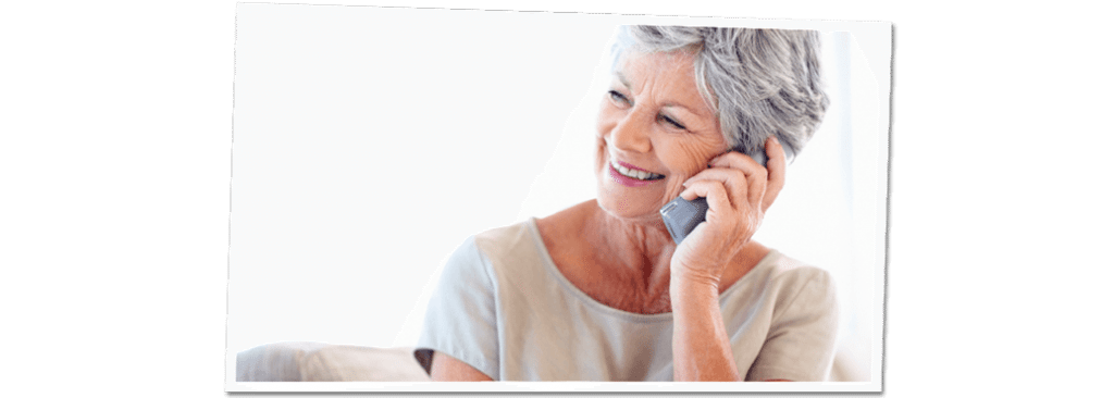 Elderly woman smiling and talking on the phone
